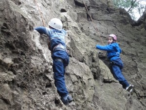 picture of student learning to climb.